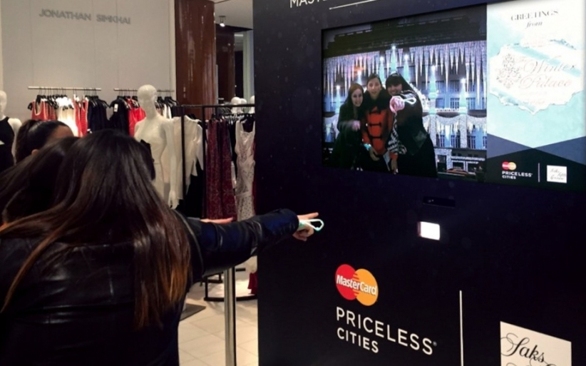 Saks users interacting with experience